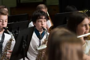 A picture of a student playing saxophone