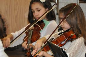 A picture of students playing violins