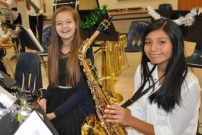 A picture of a student holding her saxophone